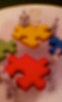 3-d red yellow puzzle people (E&I)